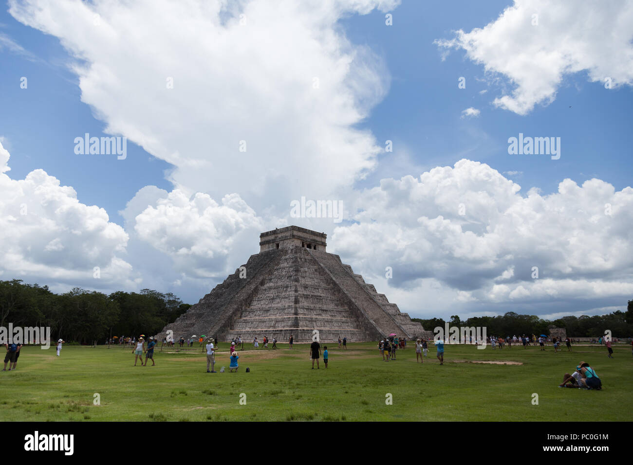 A group of tourist at 'Temple of Kukulkan (El Castillo)' most famous pyramid at Chichén-Itzá archeological site in the Yucatan peninsula Mexico. - Stock Image