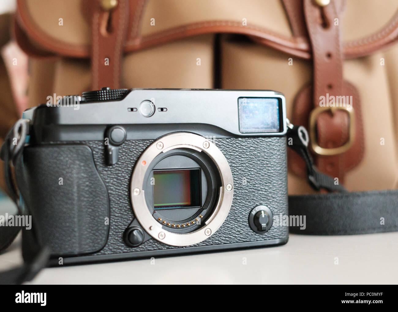 Fuji Mirrorless system camera with sensor visible, with billingham camera bag Stock Photo