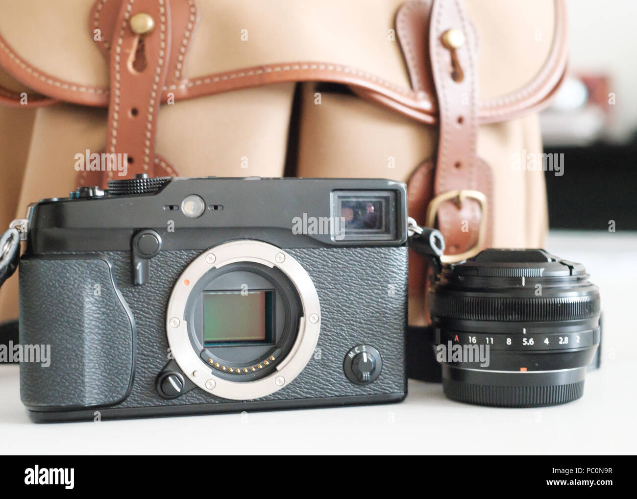 Fuji Mirrorless system camera with sensor visible, with lens and billingham camera bag Stock Photo