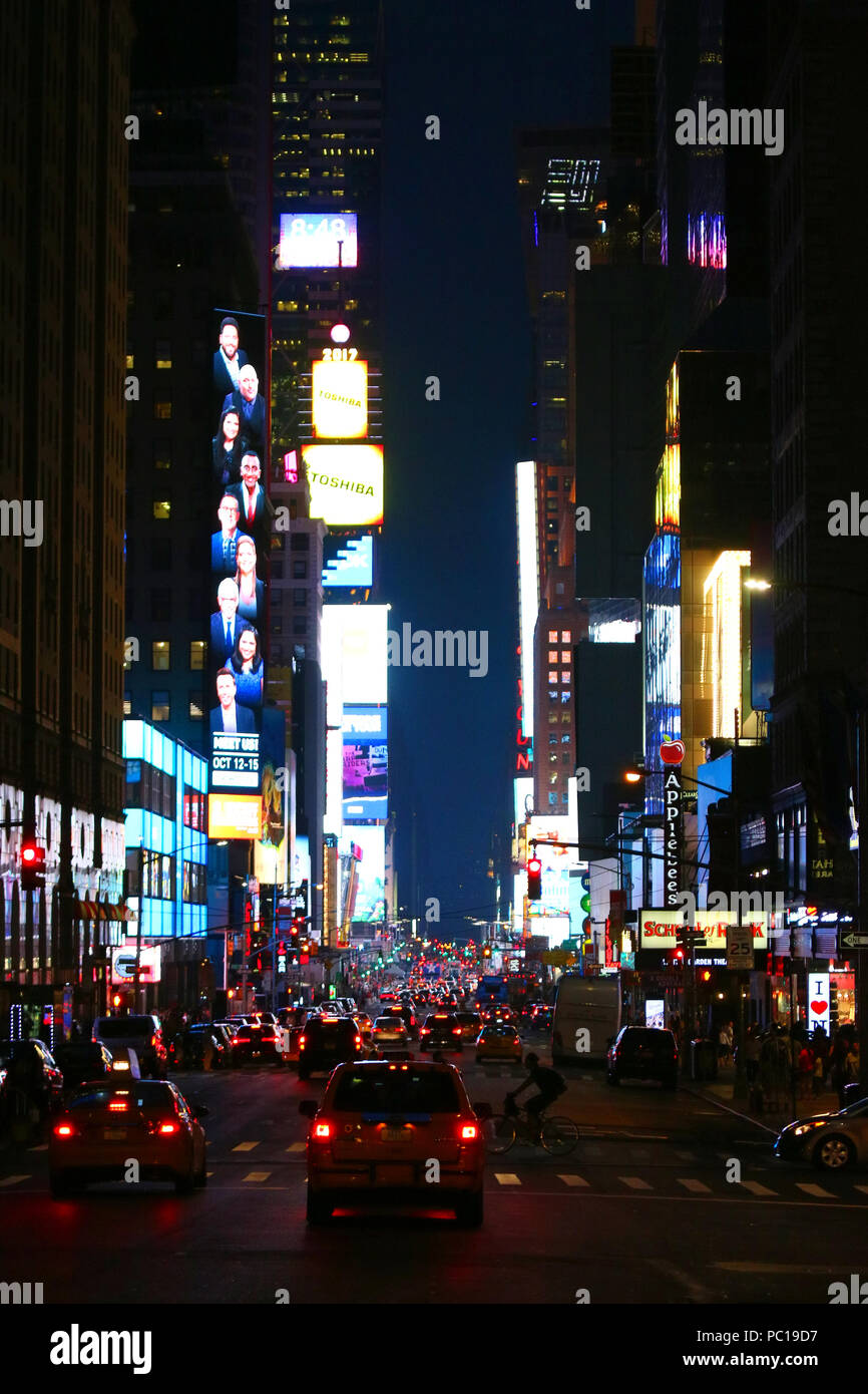 NEW YORK, NY - JULY 11: Broadway Theater District and Times Square neon lights seen south from 7th Avenue in Manhattan on evening JULY 11th, 2017 in N Stock Photo