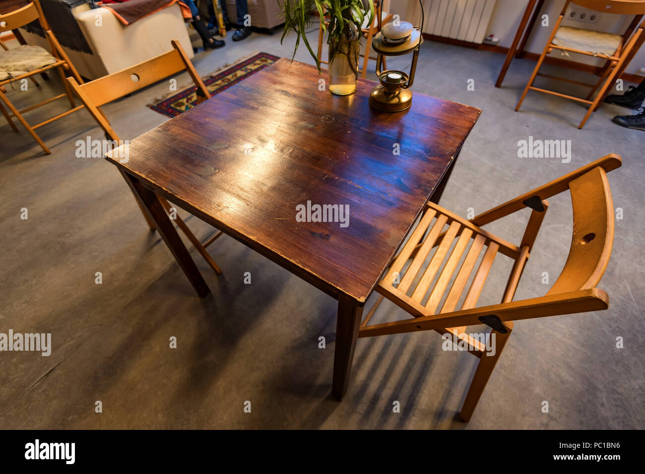 Small Wooden Table For Two In Restaurant