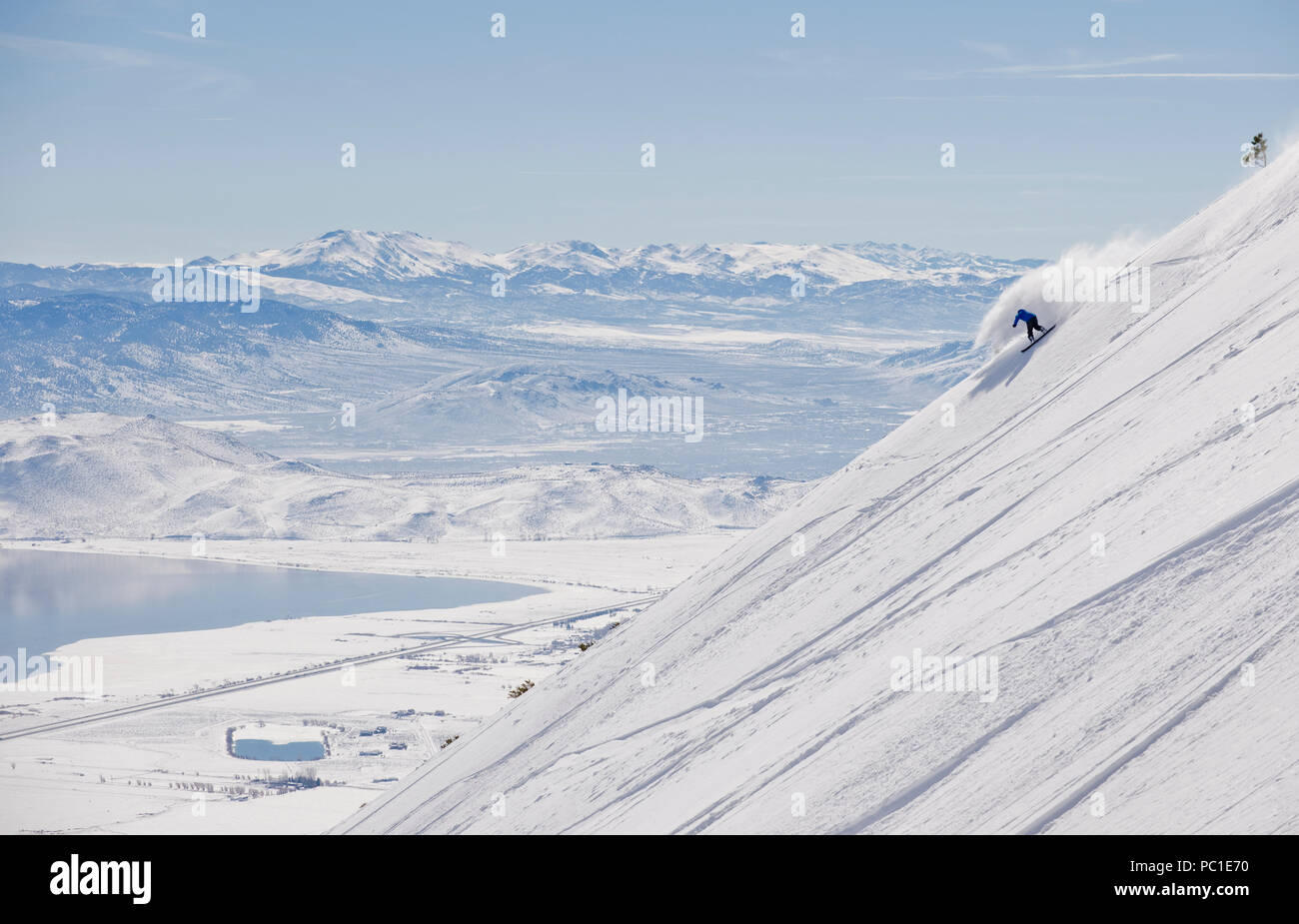 Peter Spain  enjoys 4500 vertical feet of untracked snow on the Davis Creek park run off of Mt. Rose Ski Tahoe. Stock Photo