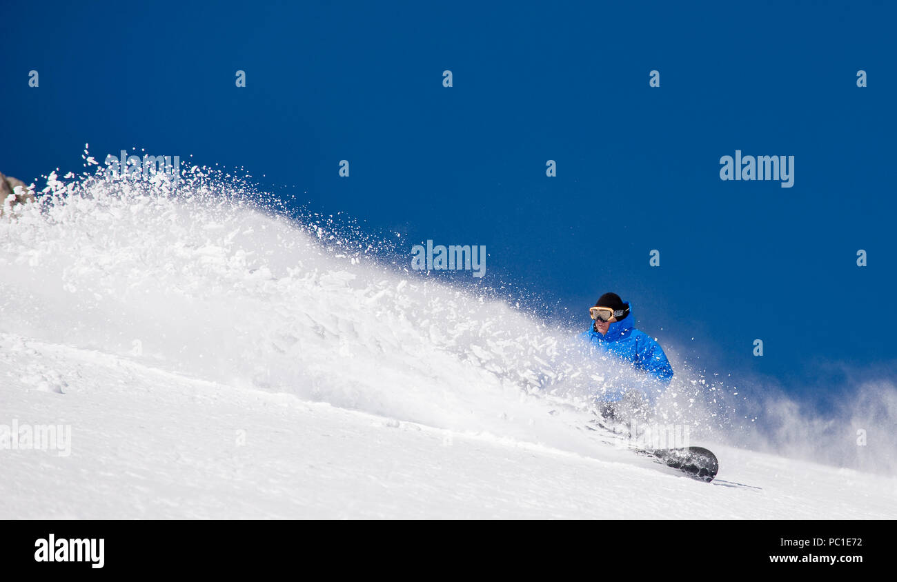 Peter Spain  enjoys untracked snow and clear blue skies on the Davis Creek park run off of Mt. Rose Ski Tahoe. Stock Photo