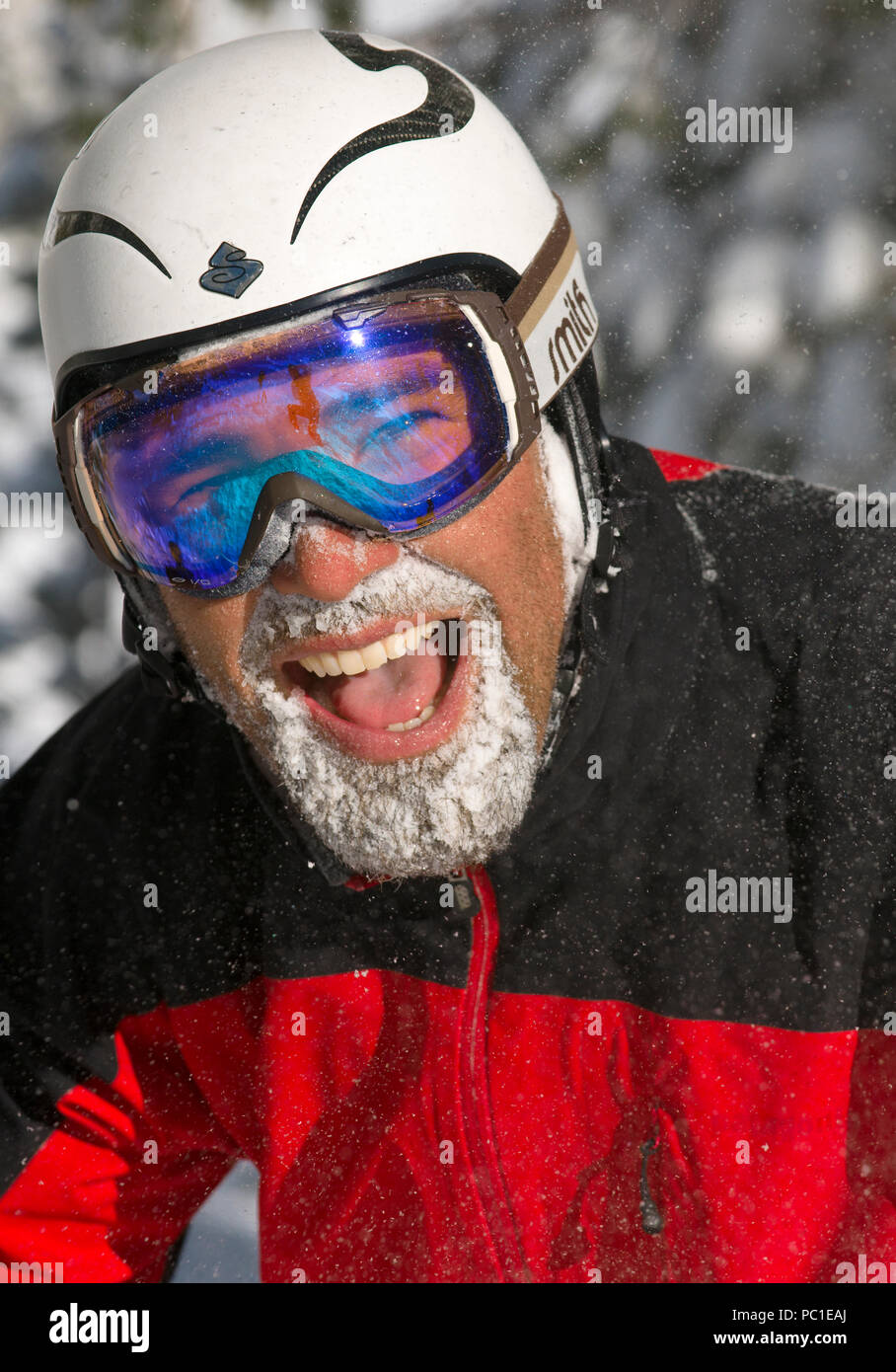 Happy skier face covered in snow after a fresh powder day at Lake Tahoe Ski resorts. Stock Photo