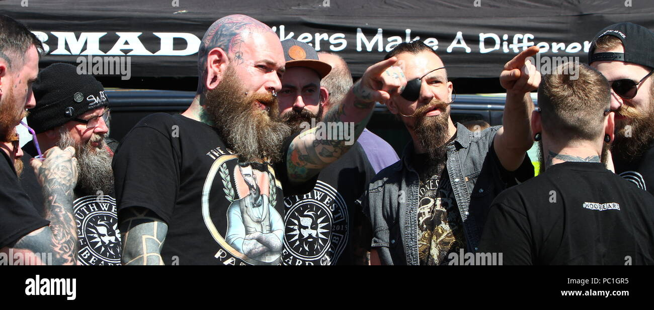 Paignton, Devon, England: A group of tattooed and bearded bikers socialise near the seafront - Stock Image