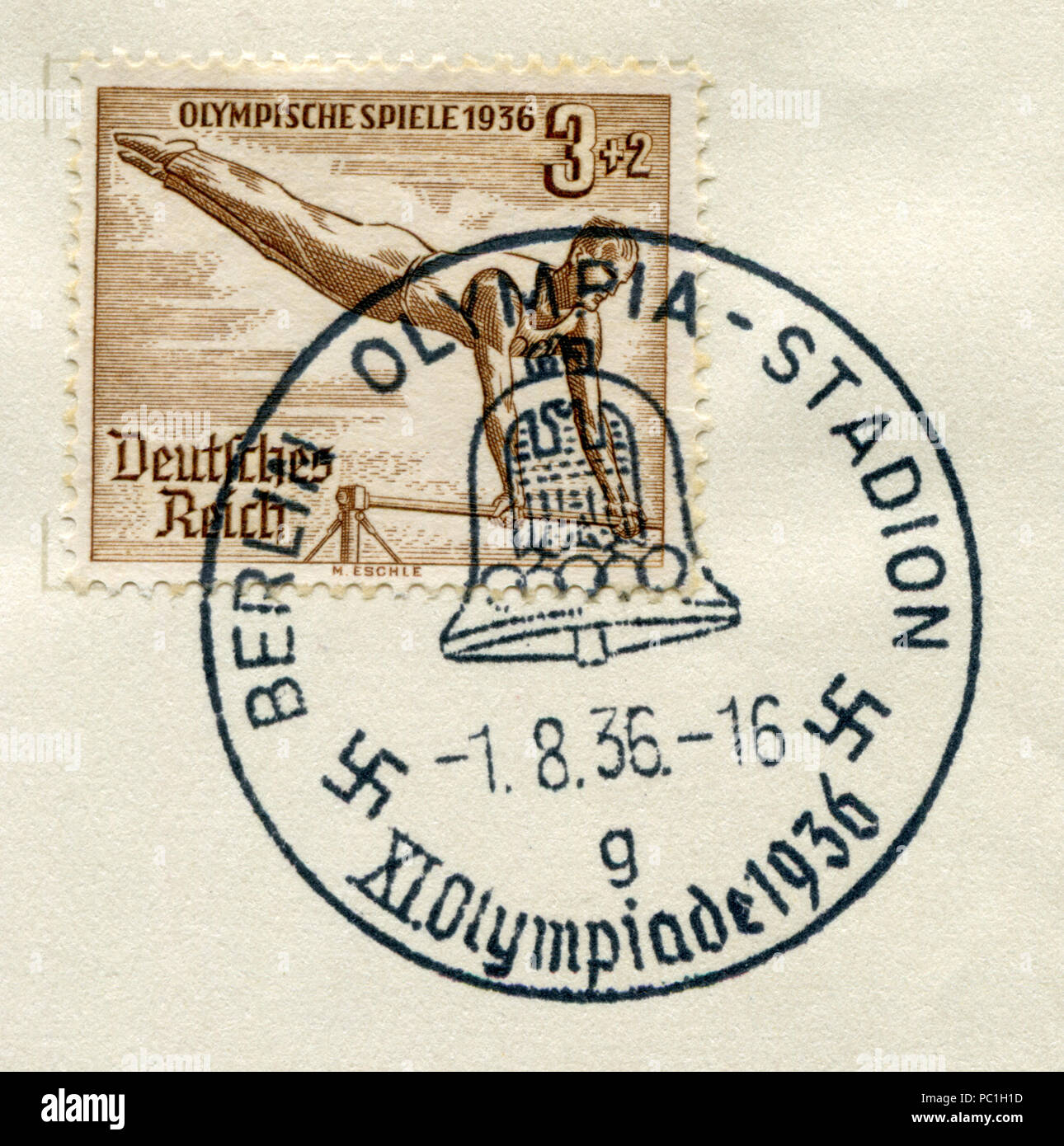 German historical stamp: 11th Summer Olympic games 1936 in Berlin, Gymnast on the bar. The Olympic stadium, special cancellation, Germany, Third Reich - Stock Image