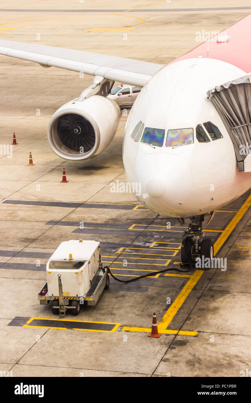 Aircraft maintenance main gear checking in the airport before departure for safety. Preflight service. - Stock Image