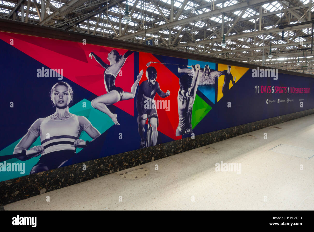 Long banner in Glasgow Central Station promoting the European Championships, Glasgow 2018, a multi-sport event hosted in the city. - Stock Image