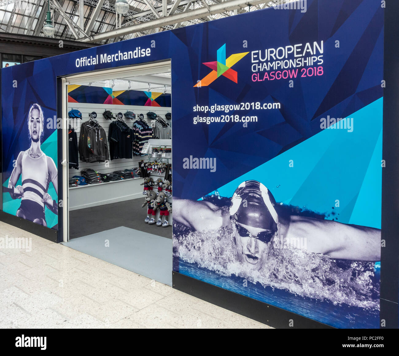 Pop-up official merchandise shop for Glasgow 2018, European Championships in the concourse of Glasgow Central Station - Stock Image