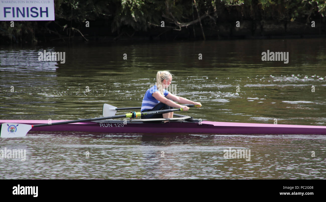 Runcorn rowing club, single women skulling, at Warrington Rowing Club 2018 Summer regatta, Howley lane, Mersey River, Cheshire, North West England, UK - Stock Image