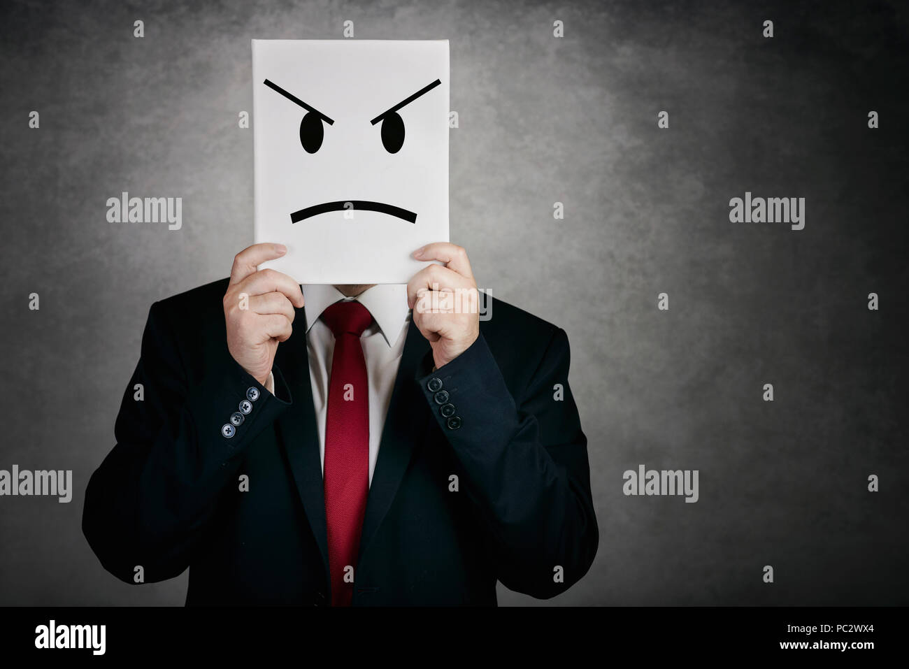 angry man with white board on gray background - Stock Image
