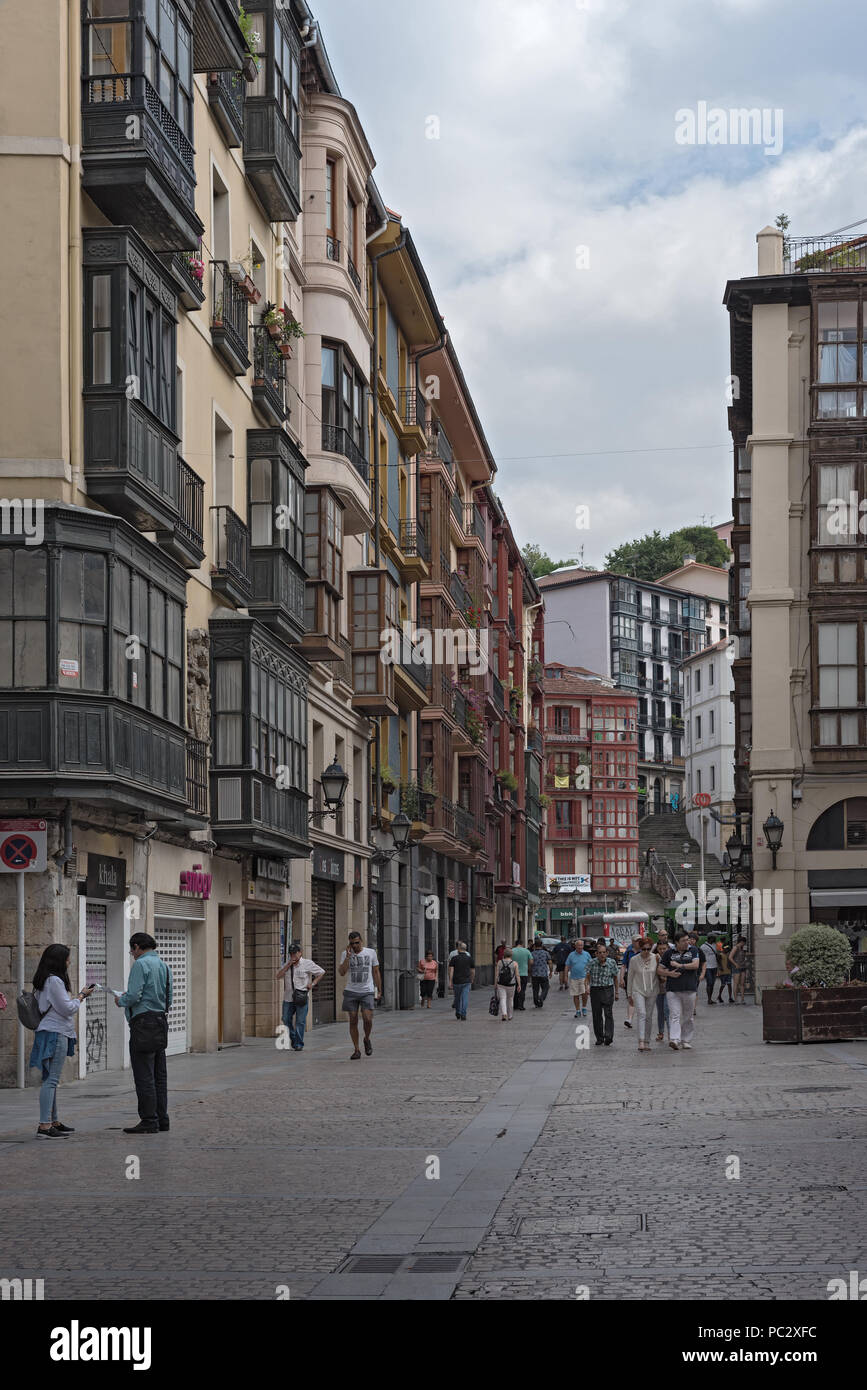 People in the narrow streets of the historic old town of Bilbao, Spain - Stock Image