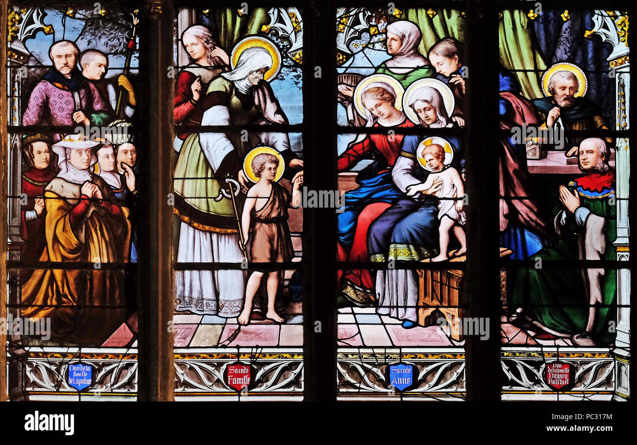 St. John the Baptist introduced by his mother, St. Elizabeth, the Infant Jesus and the Holy Kinship, stained glass in Saint Severin church in Paris - Stock Image