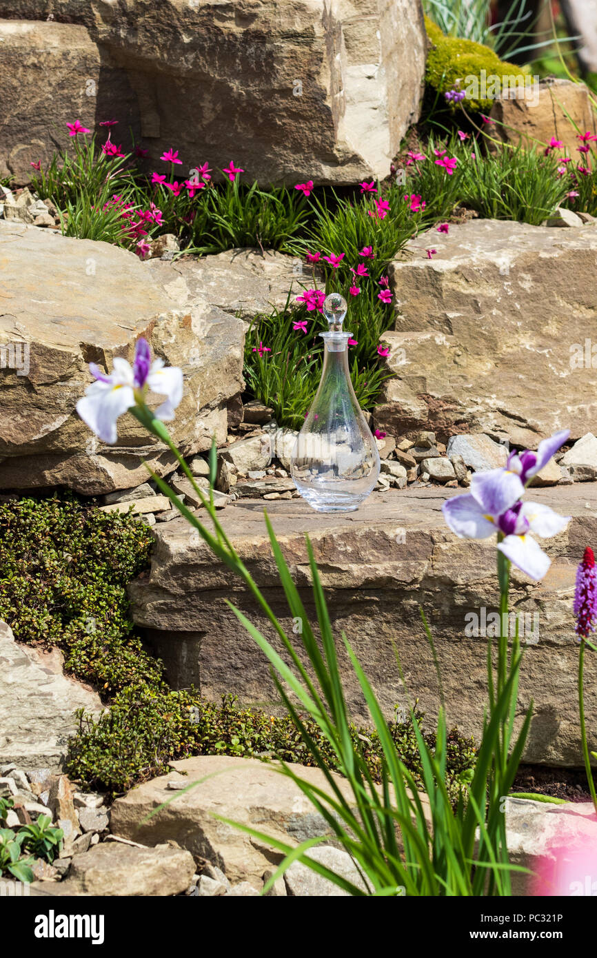 A beautiful garden rockery with alpines - Stock Image