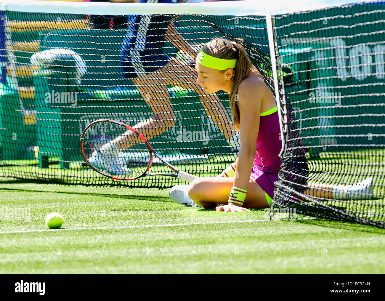 Aleksandra Krunic (Slovakia) after slipping into the net at the Nature Valley International, Eastbourne 26th June 2018 - Stock Image