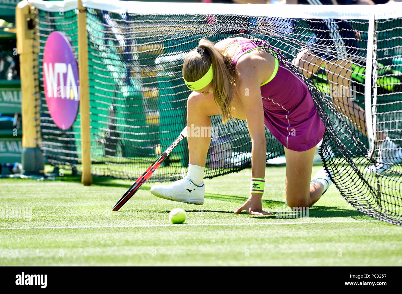 Aleksandra Krunic (Slovakia) getting up after slipping into the net at the Nature Valley International, Eastbourne 26th June 2018 - Stock Image