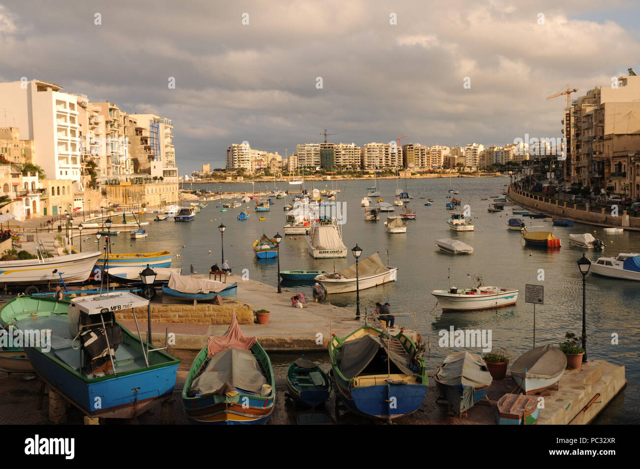St. Juliens Bay on Malta Island with fisher and sailing boats. - Stock Image