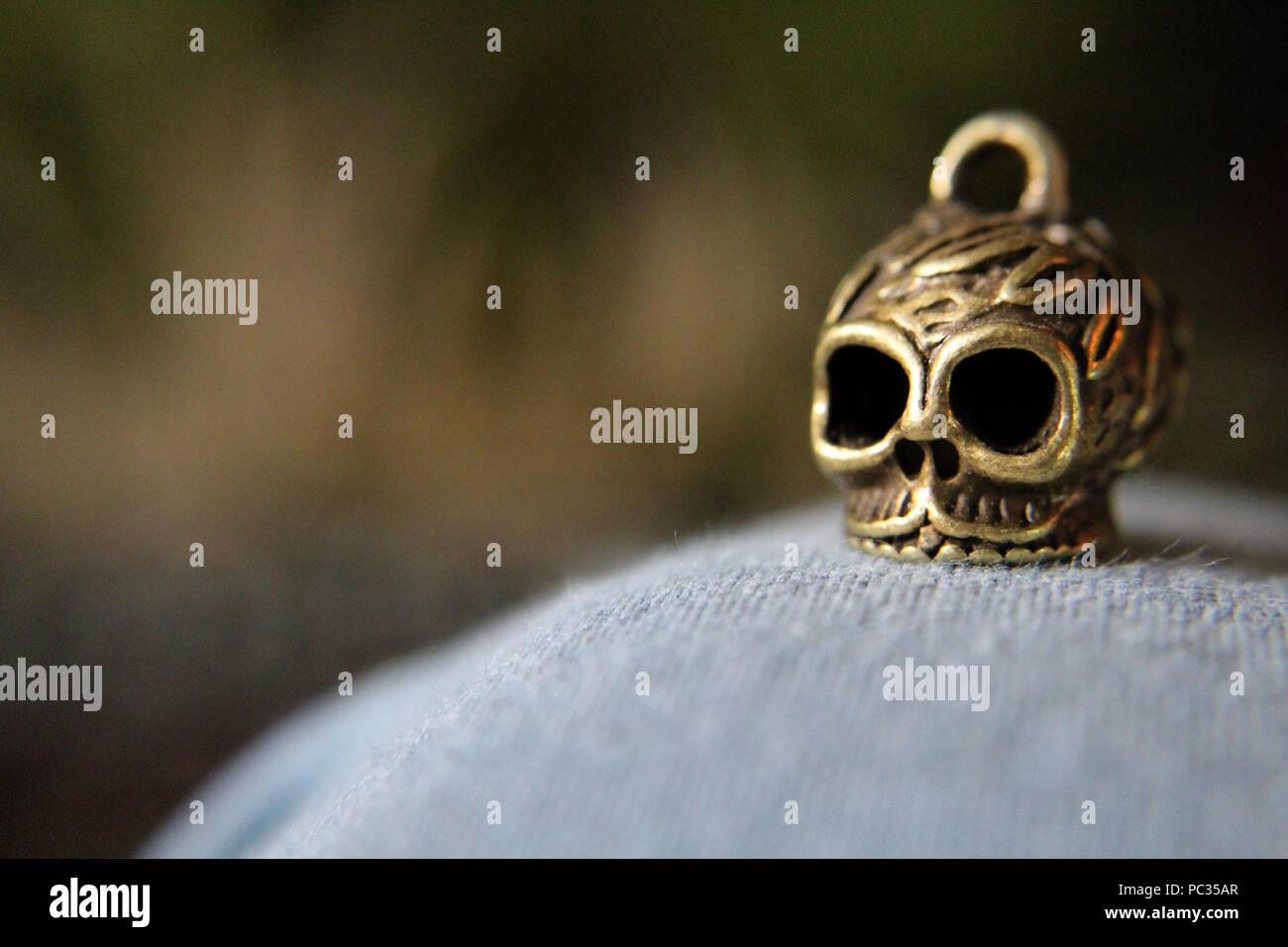 metal skull charm Stock Photo