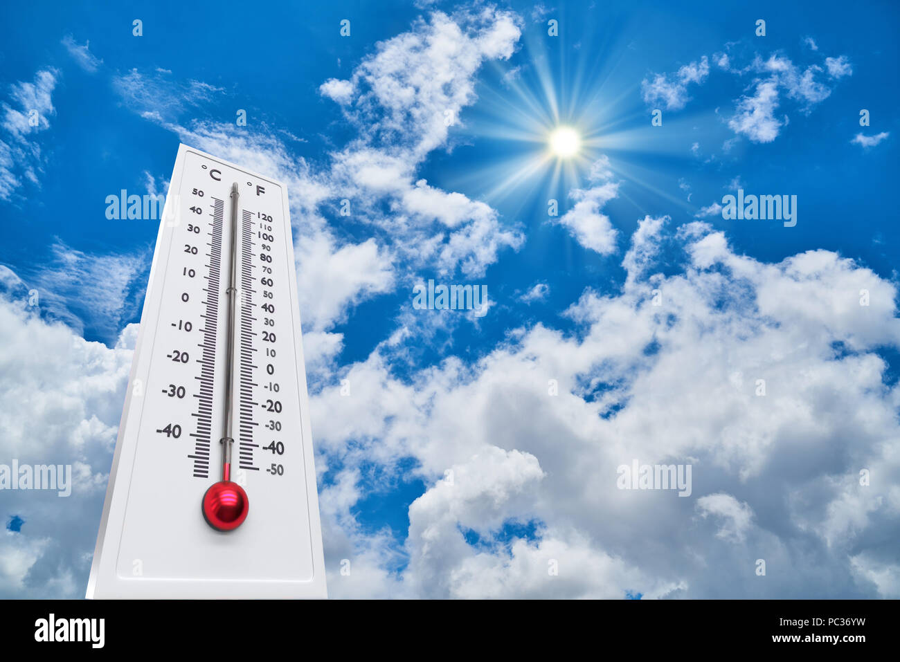 Thermometer Sun high Degres. Hot summer day. High Summer temperatures - Stock Image