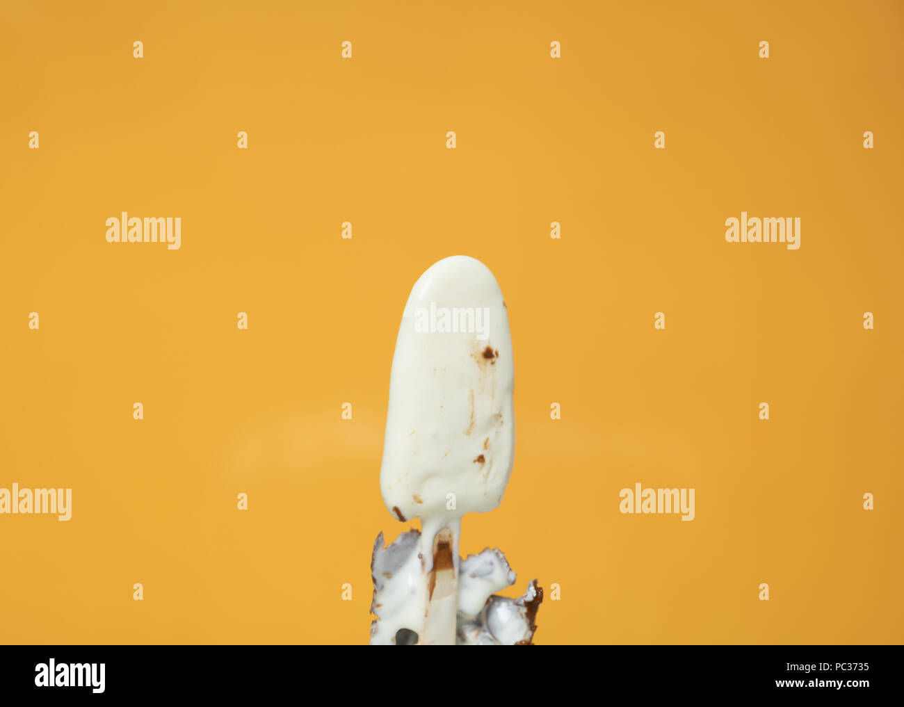 melting melted chocolate ice cream in summer hot weather - Stock Image