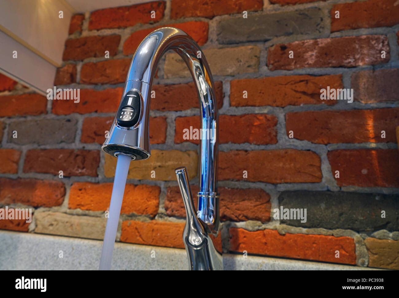 Montreal, Canada, July 31, 2018.Water pouring out of kitchen faucet.Credit Mario Beauregard/Alamy Live News - Stock Image
