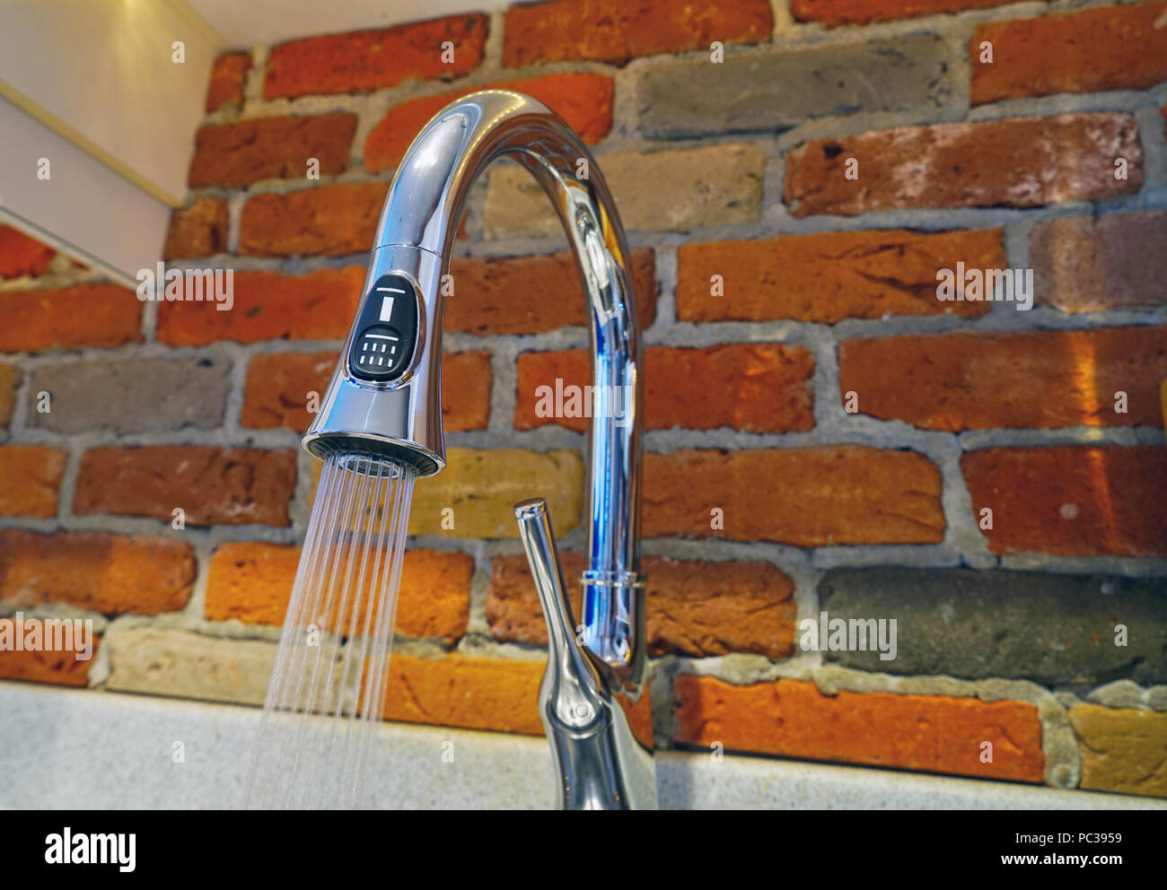 Montreal, Canada, July 31, 2018.Spray of water pouring out of kitchen faucet.Credit Mario Beauregard/Alamy Live News - Stock Image