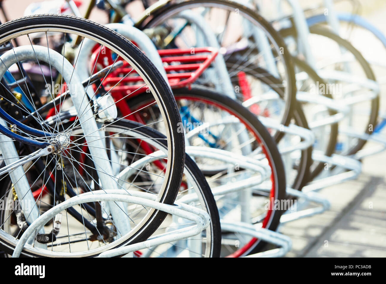 Many Different Bicycles Parked On A Parking Lot In The Urban Street Bike Wheels Locked