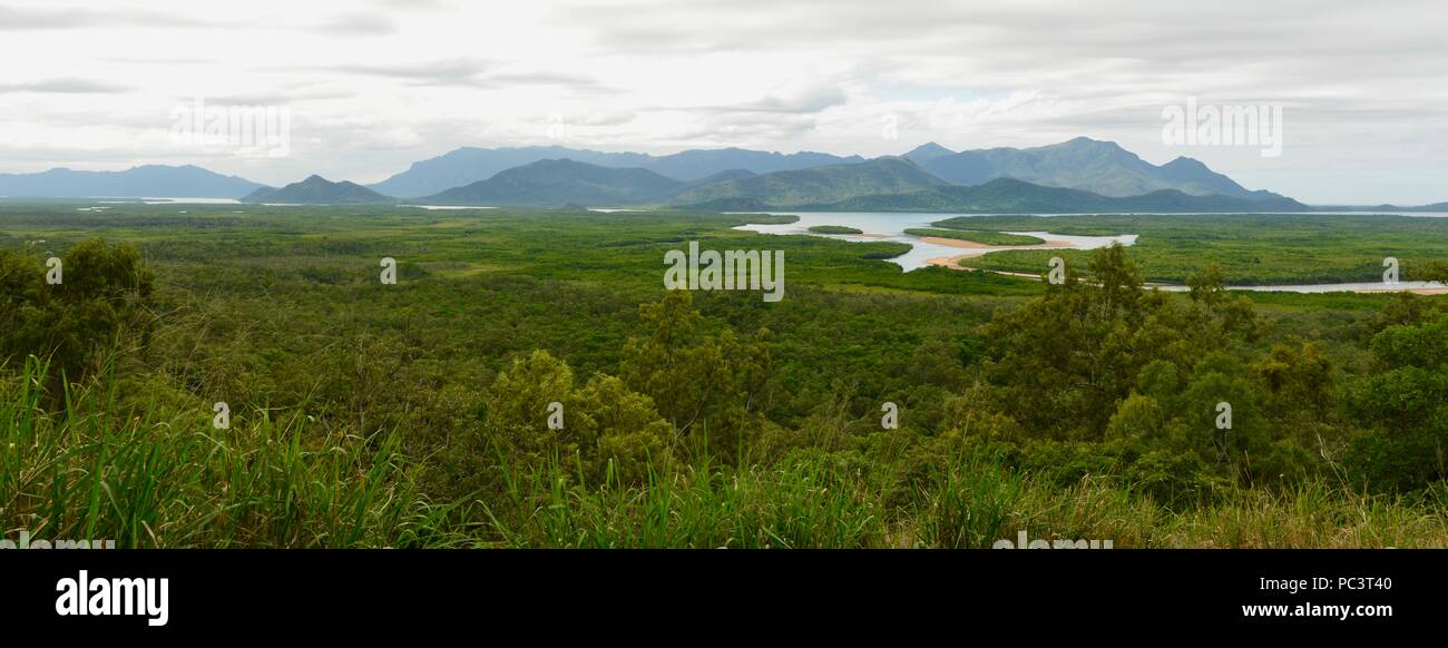 Hinchinbrook island on a cloudy misty day as seen from the Hinchinbrook island lookout, Cardwell, Queensland, Australia - Stock Image