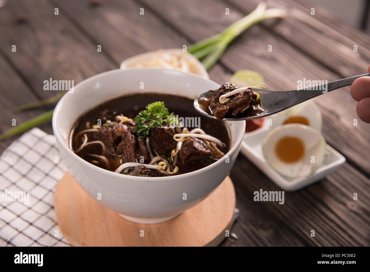 Rawon. traditional Indonesian beef black soup - Stock Image