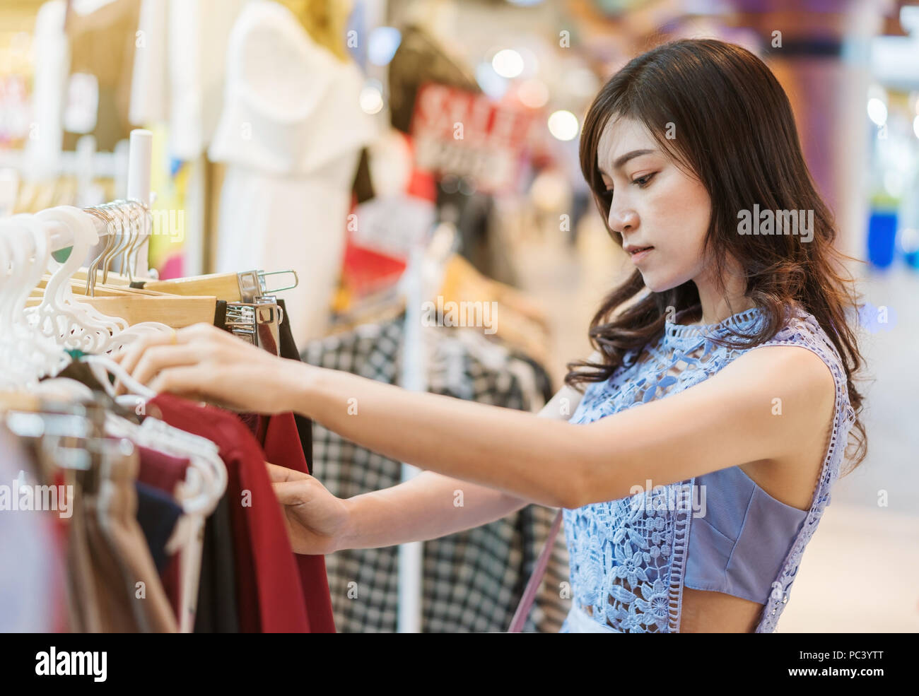 6d8bee0bbfc3f young woman shopping in a clothing store Stock Photo: 213988008 - Alamy