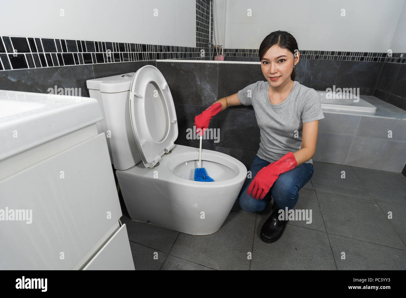 Pleasant Woman Cleaning Toilet Bowl With A Brush Stock Photo Pabps2019 Chair Design Images Pabps2019Com