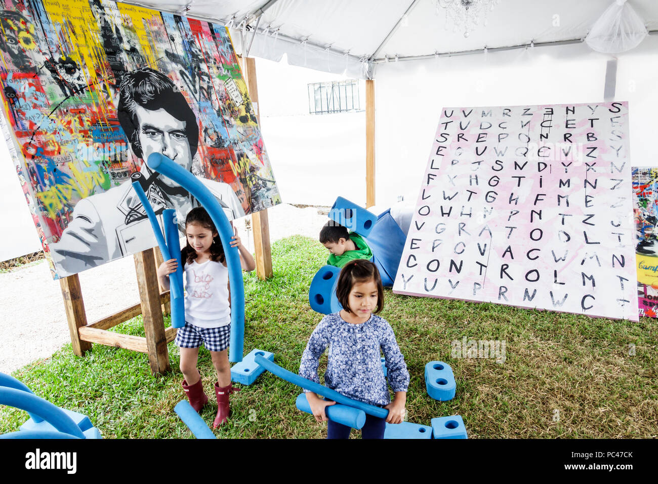 Miami Florida Wynwood Art Basel Week Mex/Art 2017 Mexican Contemporary Art Exhibition painting foam forms girl boy child playing - Stock Image