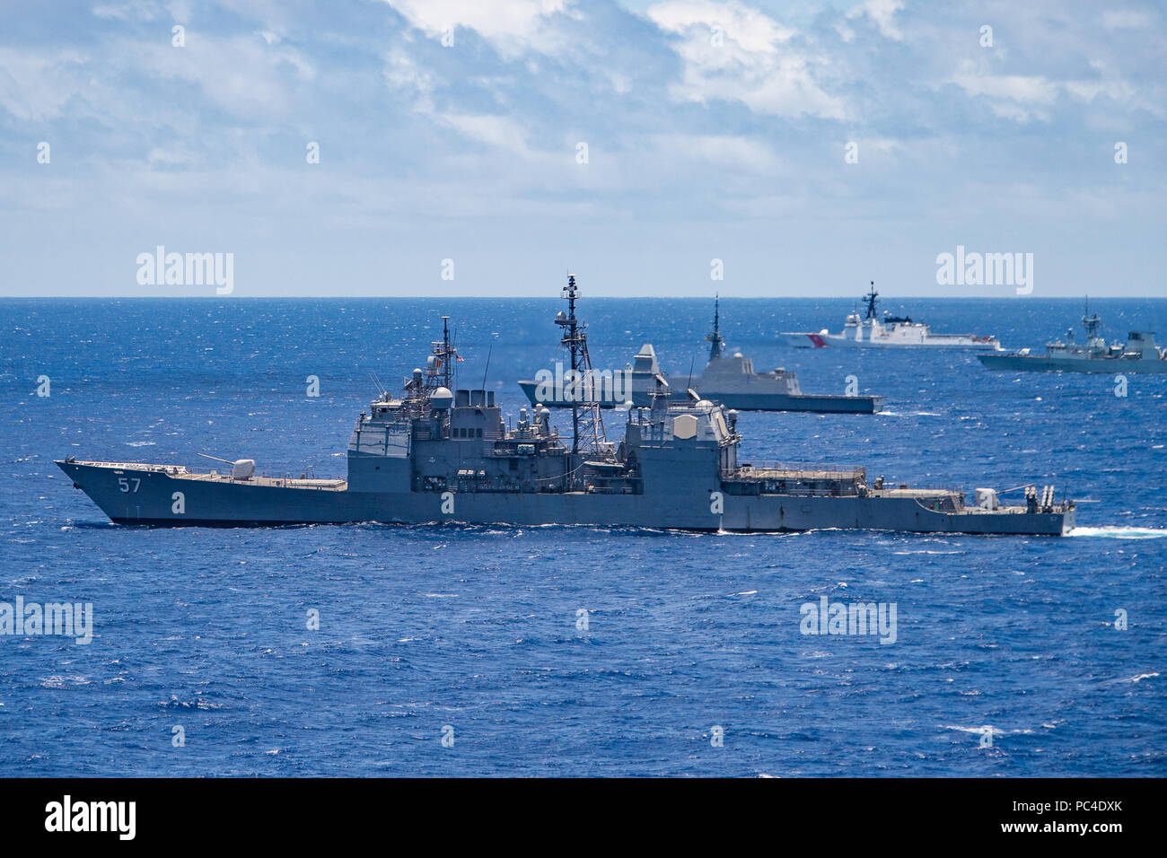 180726-N-CW570-3067 PACIFIC OCEAN (July 26, 2018) The guided-missile cruiser USS Lake Champlain (CG 57) participates in a group sail during the Rim of the Pacific (RIMPAC) exercise off the coast of Hawaii, July 26. Twenty-five nations, 46 ships and five submarines, and about 200 aircraft and 25,000 personnel are participating in RIMPAC from June 27 to Aug. 2 in and around the Hawaiian Islands and Southern California. The world's largest international maritime exercise, RIMPAC provides a unique training opportunity while fostering and sustaining cooperative relationships among participants crit Stock Photo