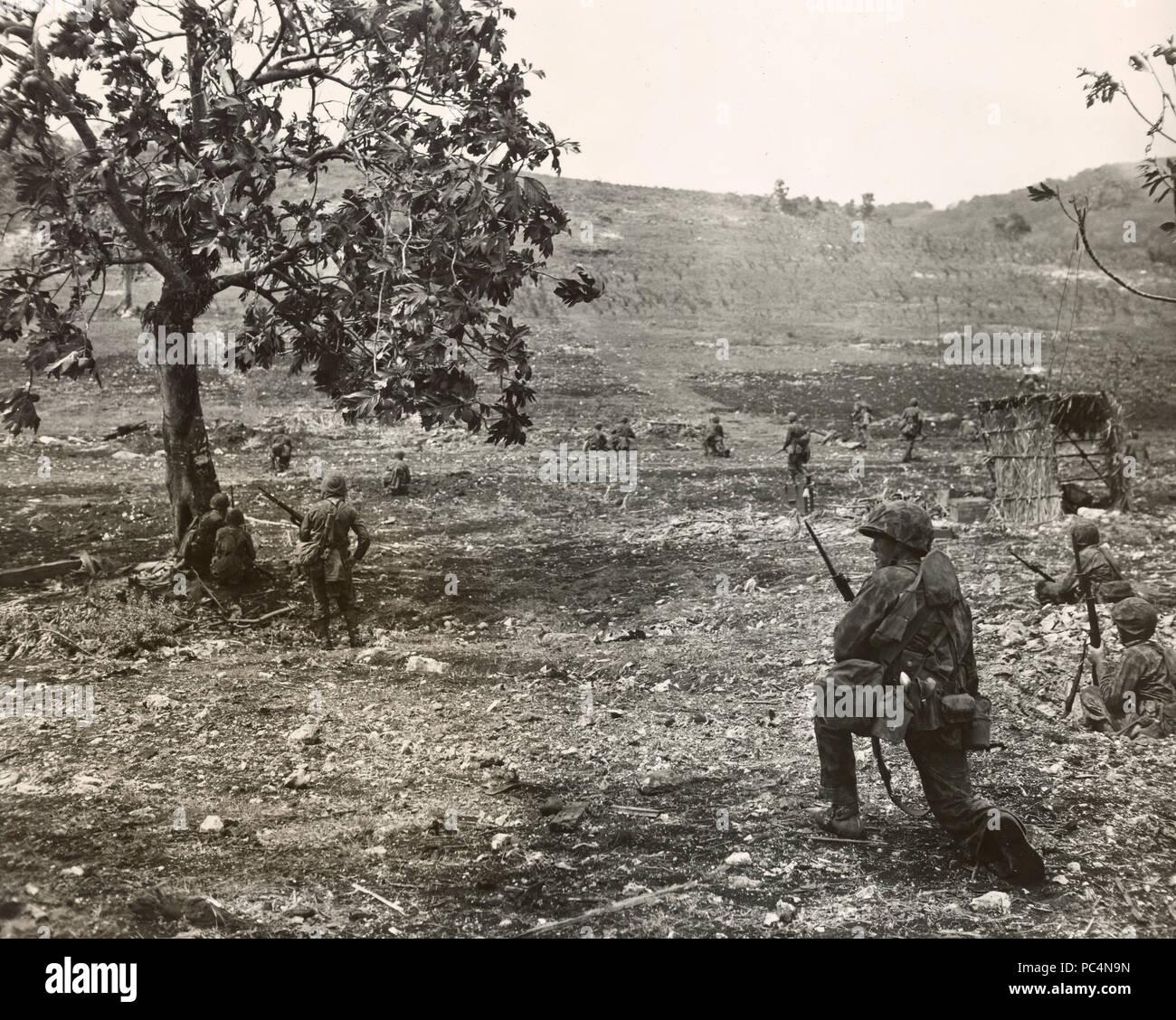 Marines on Saipan battle Japanese in open terrain Stock Photo - Alamy