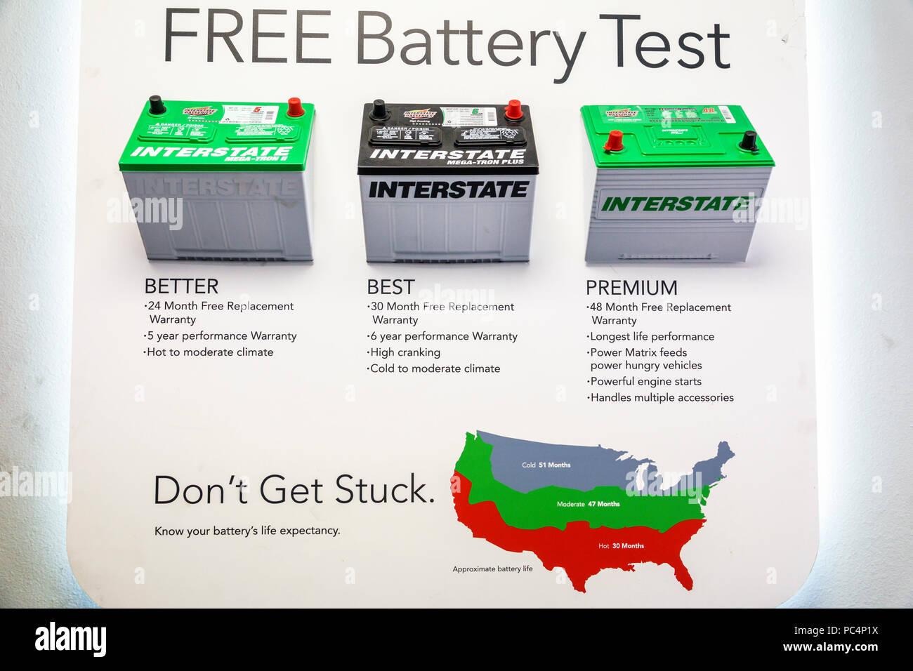 St. Saint Petersburg Florida Tire Kingdom free car battery test poster Interstate brand product comparison - Stock Image