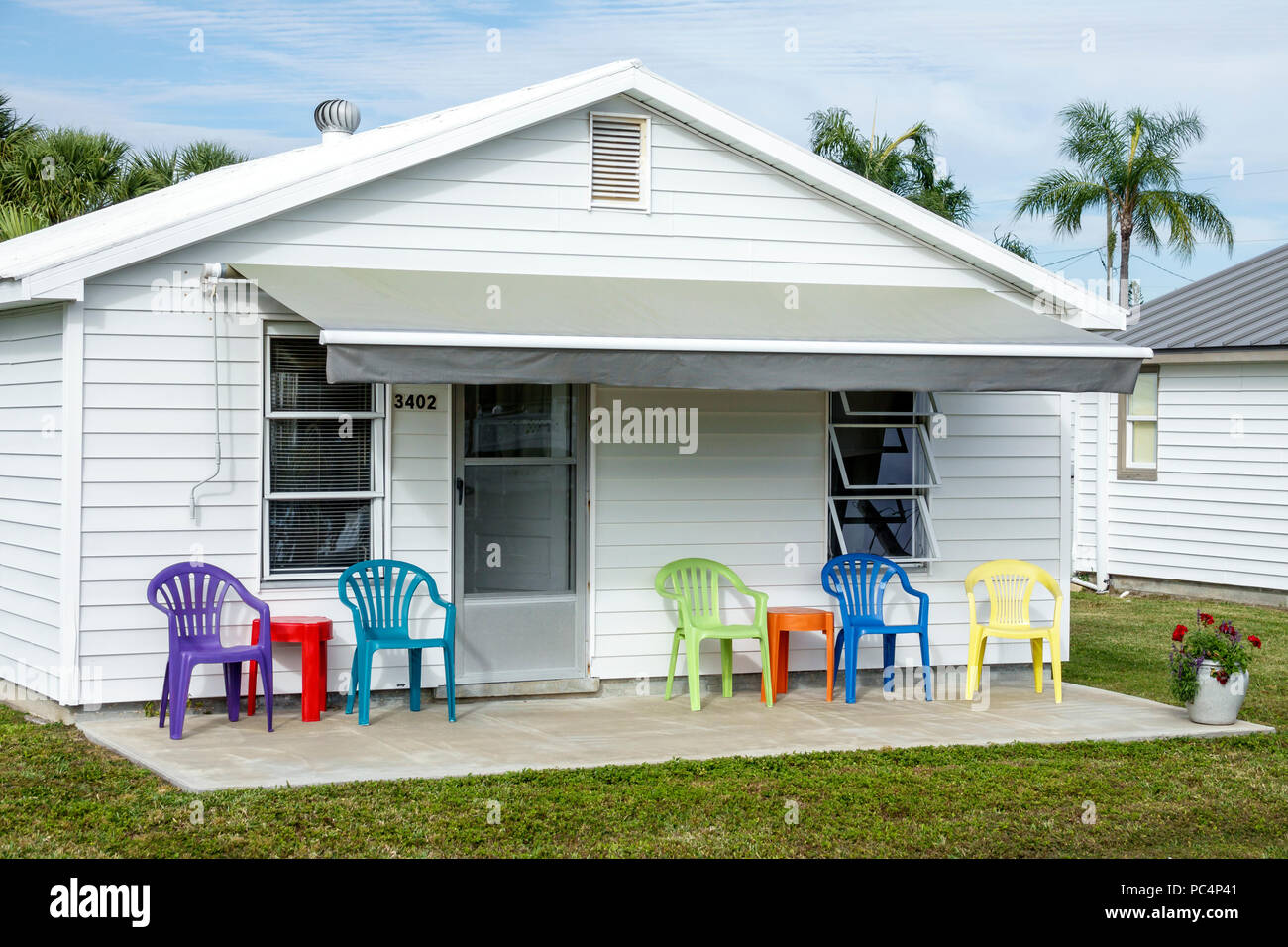 ... Pinecraft Pine Craft Amish Mennonite Snowbird Community House Home  Exterior Porch Shiplap Construction Awning Colorful Plastic Outdoor Chairs  Furniture