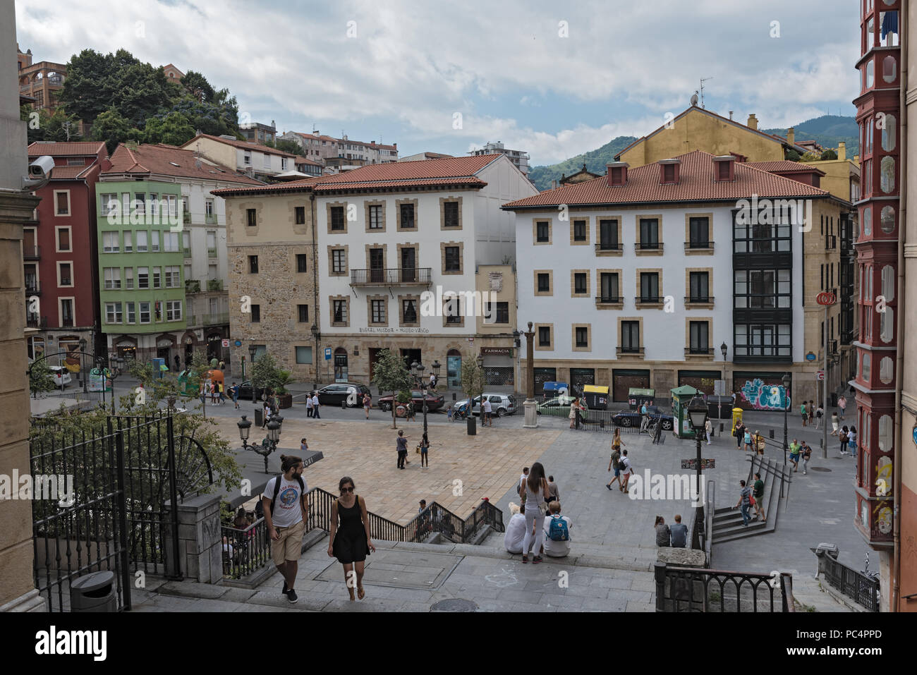 people in the square and bars on the unamuno square, bilbao, spain. - Stock Image