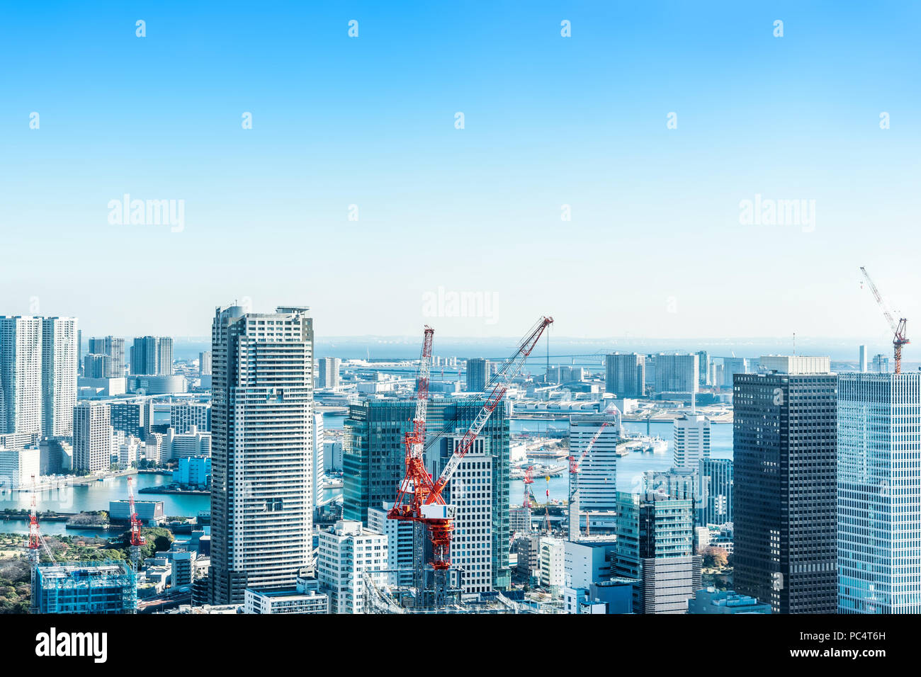 Asia Business concept for real estate and corporate construction - panoramic modern city skyline bird eye aerial view with crane near tokyo tower unde - Stock Image