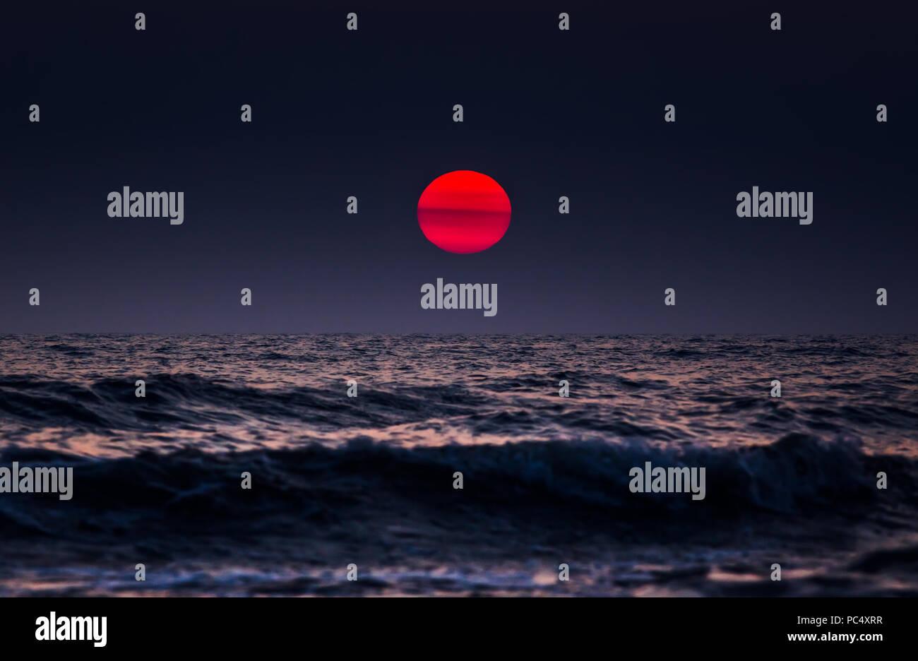 Beautiful dark sunset above the sea - Stock Image