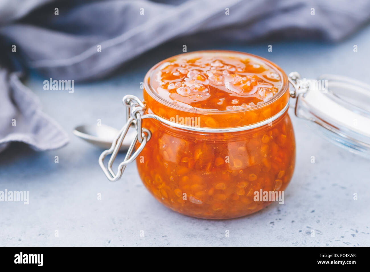 Glass jar with cloudberry jam. Nordic cuisine. Stock Photo