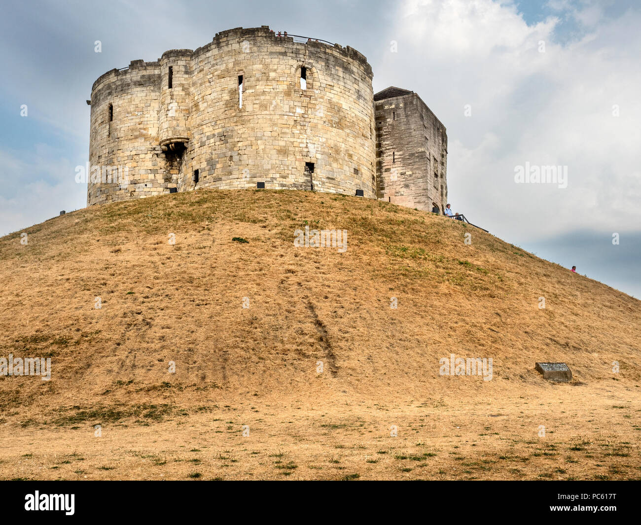 Parched grass on the banks at Cliffords Tower in the hot summer of 2018 City of York Yorkshire England - Stock Image