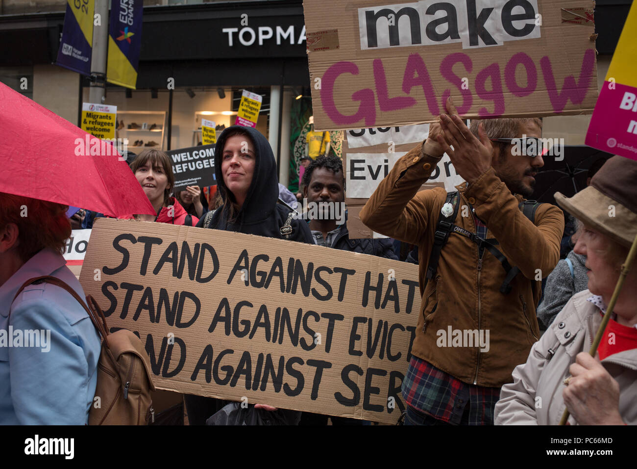 Glasgow, Scotland, on 31 July 2018. Rally in Buchanan Street, in support of refugees facing eviction by private housing company Serco. Serco announced this week that they would begin to evict asylum seekers who have had their application for refugee status rejected by the Home Office. Up to 300 refugees are facing imminent eviction. Image Credit: Jeremy Sutton-Hibbert/ Alamy News. - Stock Image
