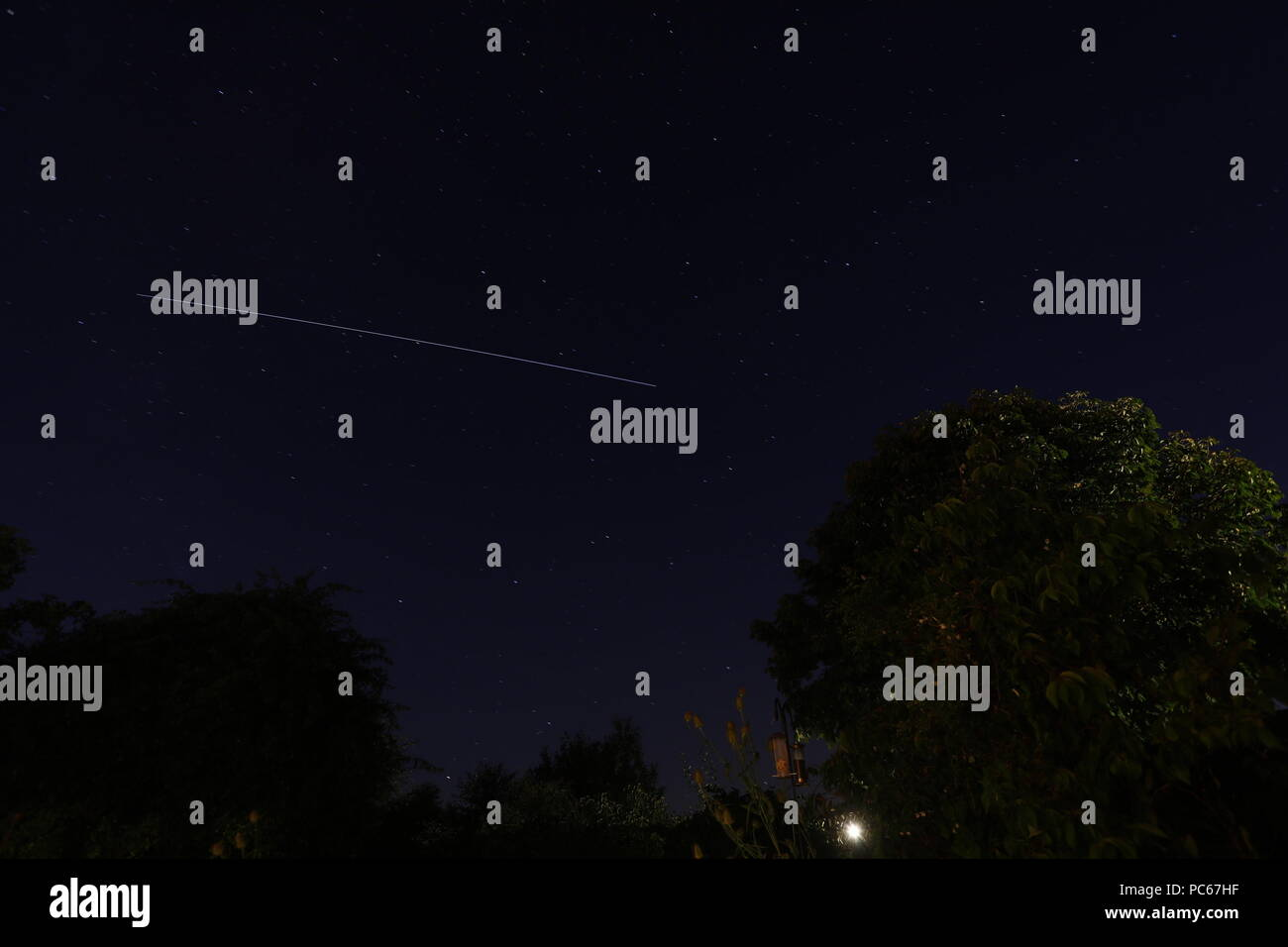 31st Jul 2018. UK weather. Clear skies this evening allow good views of the International Space Station over Hailsham,East Sussex, UK Credit: Ed Brown/Alamy Live News - Stock Image