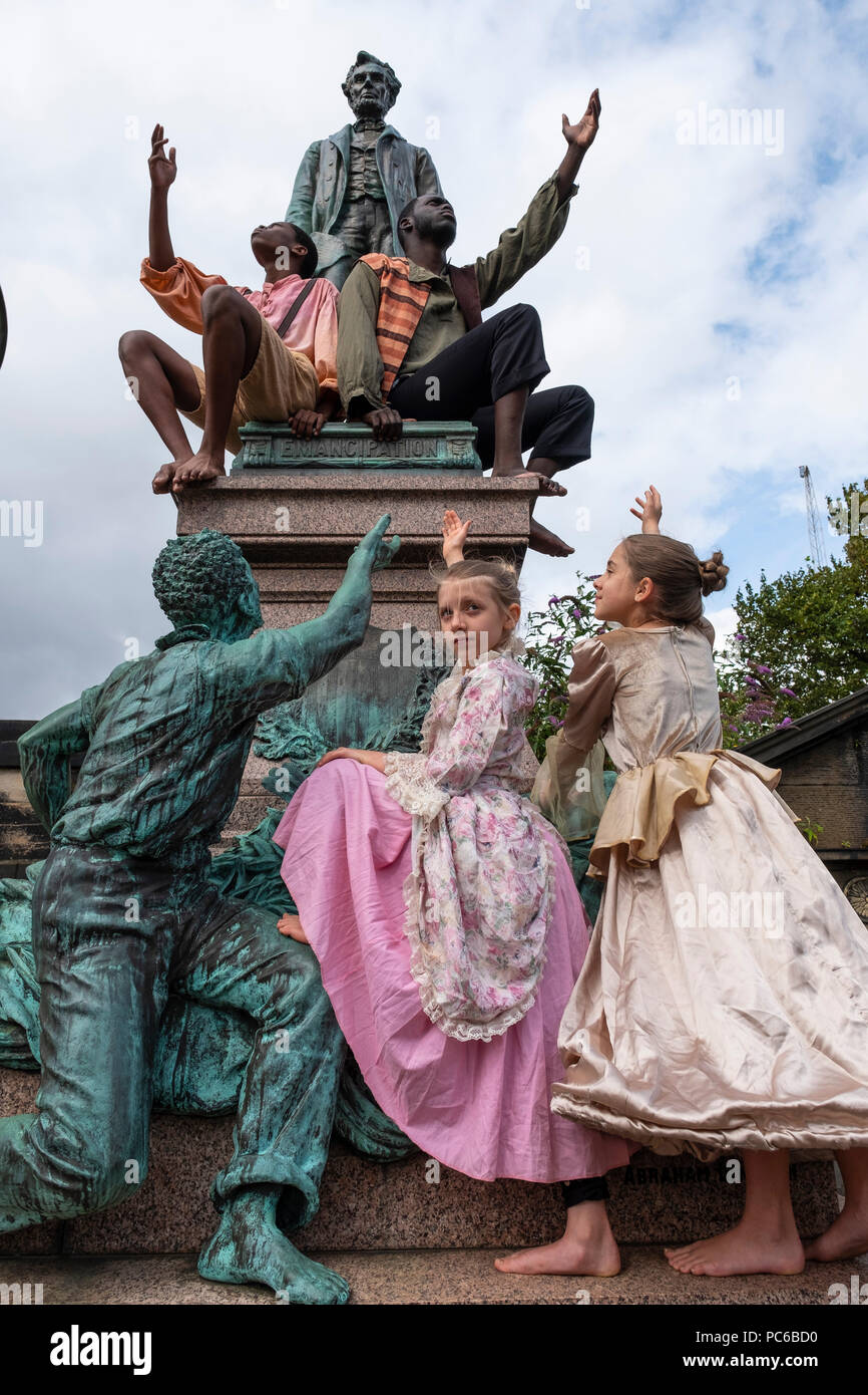 Edinburgh, Scotland, UK; 1 August, 2018. The cast of Henry Box Brown: a Musical Journey at the statue of President Lincoln in the Old Calton Burial Ground, Edinburgh. New York Gospel singers from a new Edinburgh Fringe musical about an American slave shipped to freedom in a 3ftX2ft box gather at American Civil War Memorial to honour the Scots who fought against slavery in the American Civil War. Credit: Iain Masterton/Alamy Live News Stock Photo
