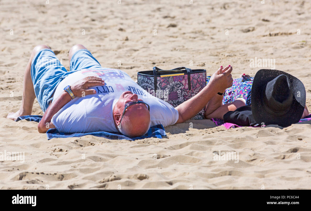 Bournemouth, Dorset, UK. 1st Aug 2018. UK weather: beach-goers head to the seaside to enjoy the warm sunny weather at Bournemouth beaches. Credit: Carolyn Jenkins/Alamy Live News - Stock Image