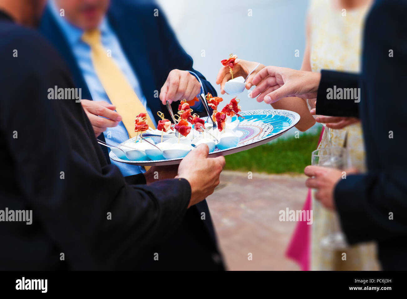 Food and catering. Wedding celebration and banquet. Wedding guests eating an appetizer Stock Photo
