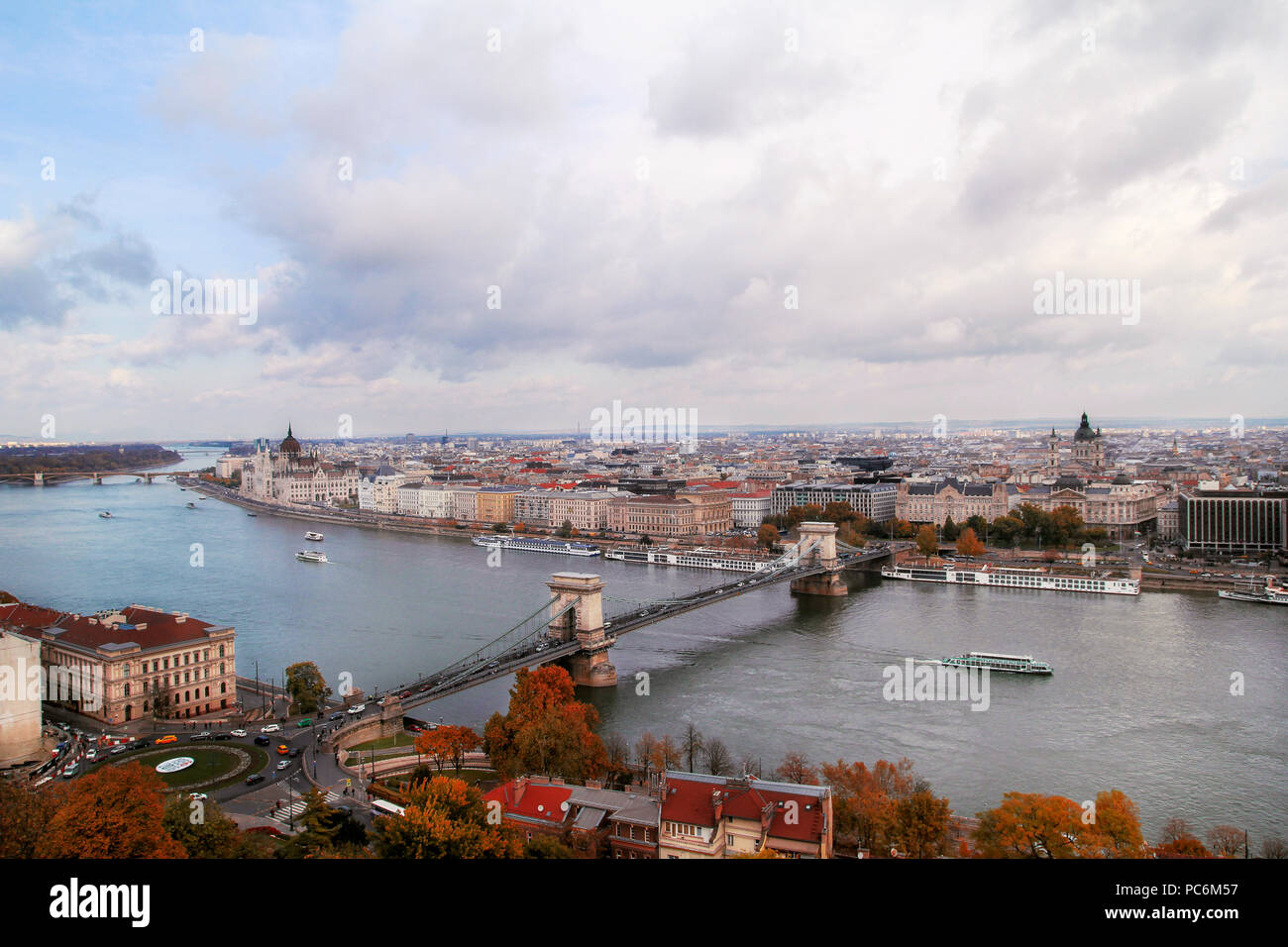 Budapest, Hungary - October 29, 2016: Landmark of Budapest, Chechen Chain Bridge that spans the River Danube between Bud and Pest. Buildings at the ba Stock Photo