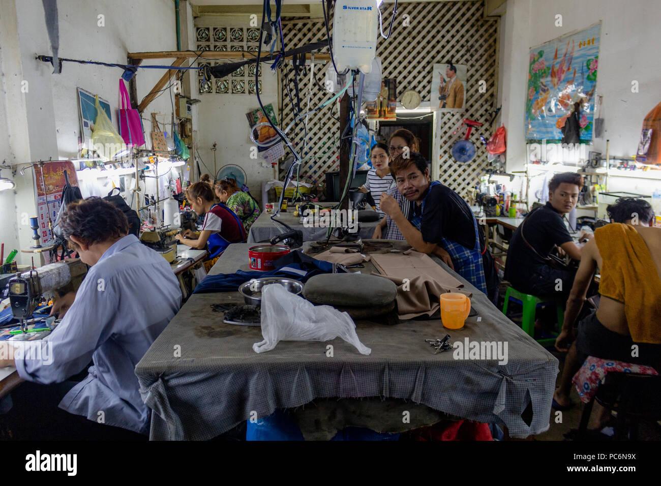 Bangkok, Thailand - May 1, 2018: People sewing in a local tailor workshop in Bangkok Stock Photo