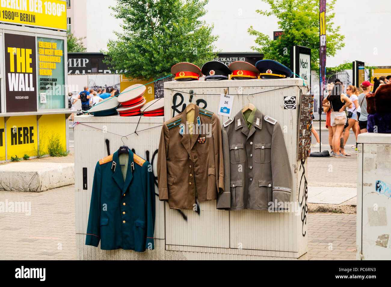 Original military WW2 uniforms for photography hire by the historic Berlin Wall and Checkpoint Charlie. - Stock Image
