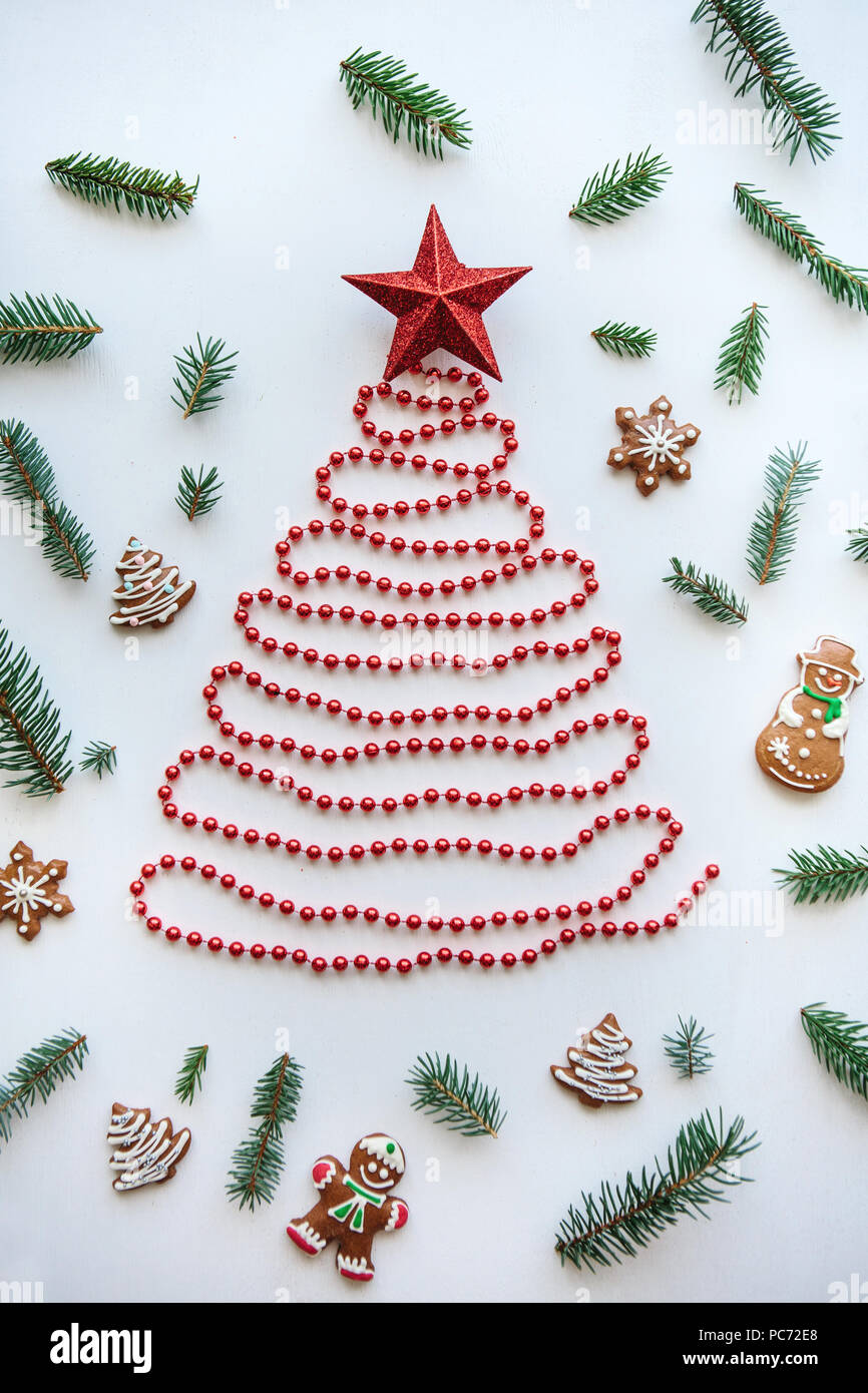 Creative Idea For Christmas Or New Year Theme A Christmas Tree Made Of Beads And A Star On Top Next To It Lie The Traditional Gingerbread And Spruce Branches For Decoration Stock
